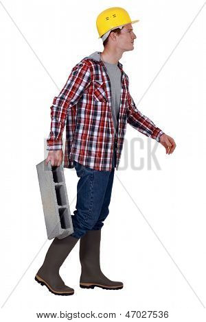 Mason carrying breeze block