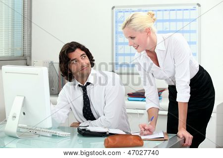 Attractive couple working in an office