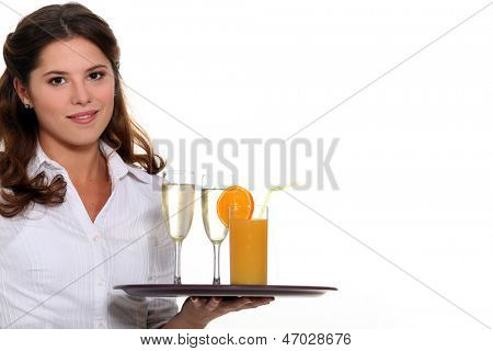 Waitress carrying tray of drinks
