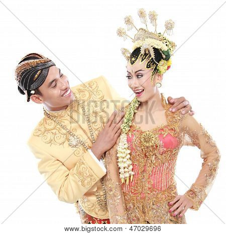 Happy Traditional Java Wedding Couple Husband And Wife Embrace Each Other