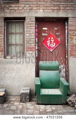 Abandoned armchair in a dusty hutong, Kaifeng, China