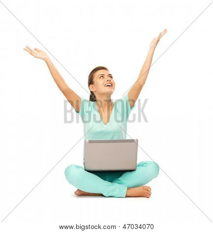 picture of happy girl sitting on the floor with laptop