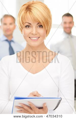 bright picture of attractive businesswoman with notebook
