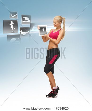 beautiful woman holding tablet pc with sport application