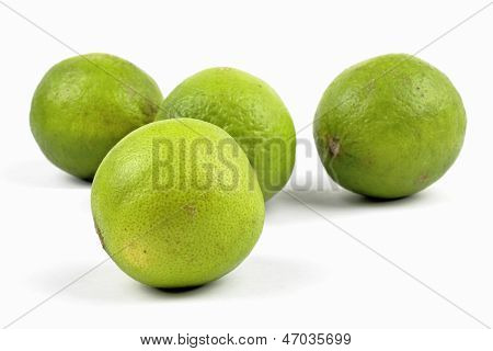 close up of limes on the white background