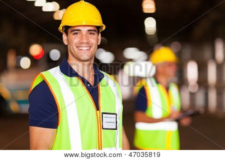 portrait of smiling young warehouse worker indoors