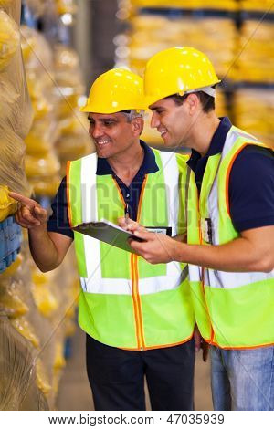 two warehouse workers doing stock take