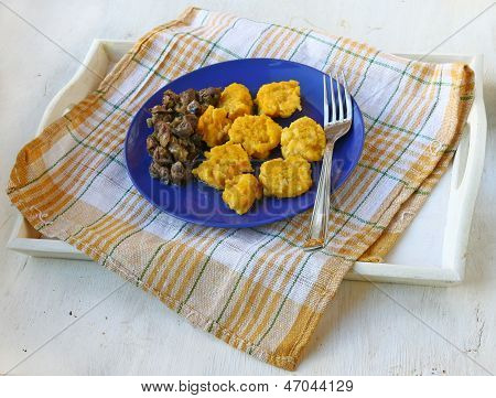 Dumplings From A Pumpkin And Potato With The Fried Chicken Hearts On Dark Blue A Dish