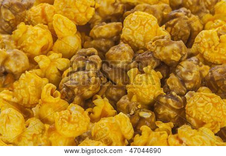 A pile of caramel and cheese corn on a white background