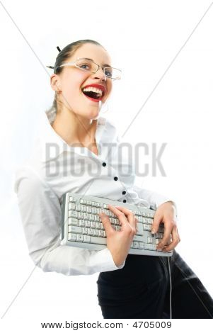 Happy Businesswoman With A Keyboard