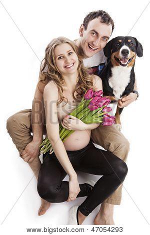 Pregnant couple and Entlebucher Sennenhund dog
