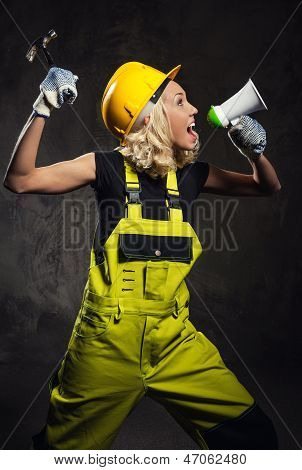 Attractive Builder Woman Shouting Through Megaphone