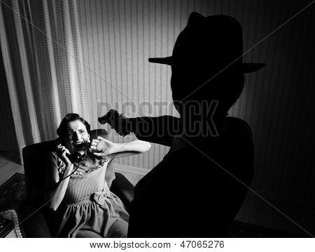 Killer Pointing The Gun At A Terrified Woman