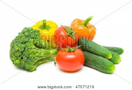 Tomatoes, Broccoli, Peppers And Cucumbers Isolated On White Background