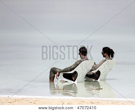 Young Caucasian  Couple Taking Mud Treatment