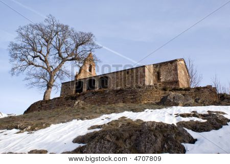 Stone Chapel Next To Tree.