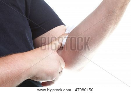 Appying A Swab To An Arm After Blood Sample