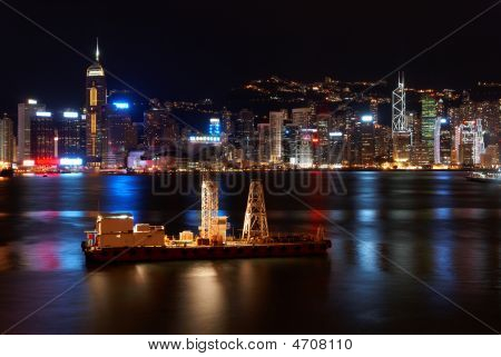 Small Freight Ship In Hong Kong At Night