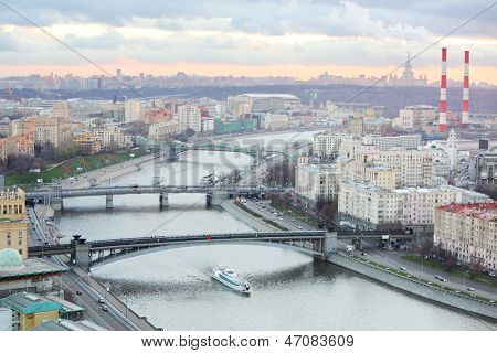 Bridge of Bogdan Khmelnitsky, Borodinsky bridge, Smolensky Metro Bridge on Moskva river in evening in Moscow, Russia.
