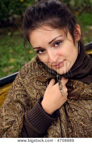A Woman Shawling In Neckpiece