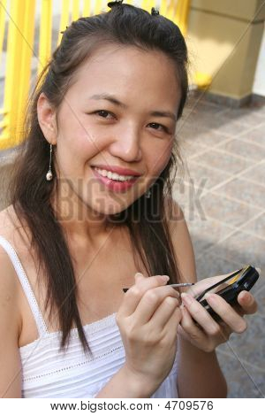 Woman Holding A Cell Phone Pda