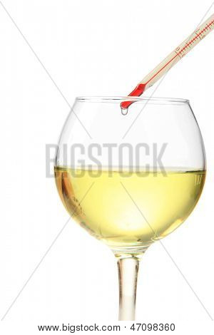 Glass of wine with thermometer, isolated on white