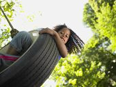 foto of tire swing  - Portrait of girl on tire swing - JPG