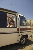 picture of motorhome  - Family looking out of motorhome window - JPG