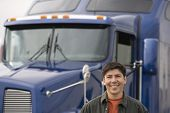picture of truck  - Man standing in front of truck - JPG