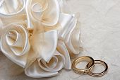 picture of rings  - wedding favors and wedding ring on on colored background - JPG