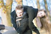 Funny Caucasian Young Couple Making Piggyback Together