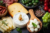 foto of cheese platter  - Antipasto and catering platter with different meat and cheese products - JPG
