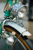 foto of dynamo  - Old retro bicycle front macro view with dynamo - JPG