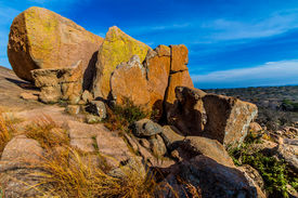 image of granite dome  - Big Rocks.  Amazingly Large Granite Boulders with Yellow Lichen of the Legendary Enchanted Rock, a Small Dome Mountain, in the Texas Hill Country.