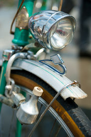stock photo of dynamo  - Old retro bicycle front macro view with dynamo - JPG