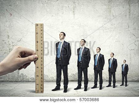 Successful confident businessmen standing in line. Progress in career