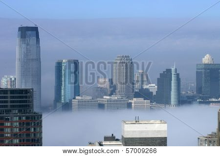 NEW YORK - JANUARY 15: Intense fog blankets the lower Manhattan New York Harbor area on January 15, 2014 in New York.