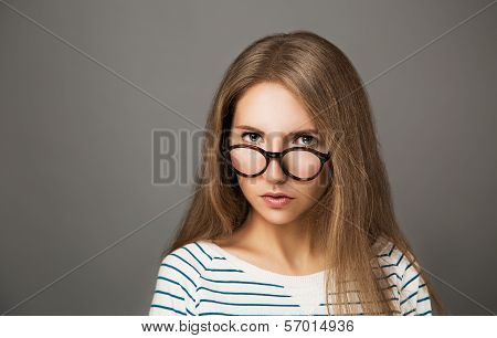 Portrait of Trendy Hipster Girl in Glasses