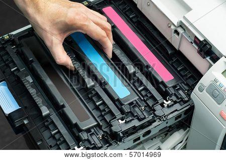 Man Puts Toner In The Printer