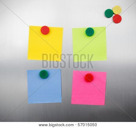 Coloured Notes And Magnets On Inox Metallic Fridge
