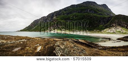 Long Exposure Panoramic Shot Of The Beach Mjelle In Northern Norway