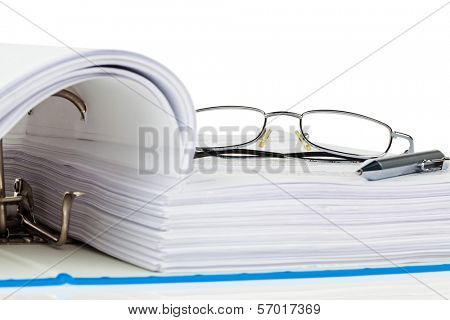 a file folder with documents and documents. retention of contracts.