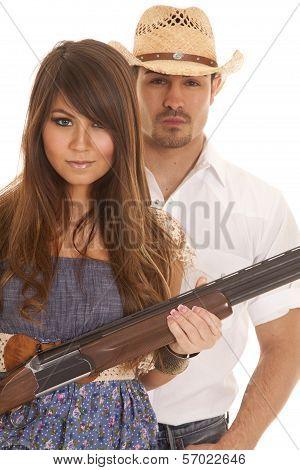 Cowboy Behind Woman With Gun Serious