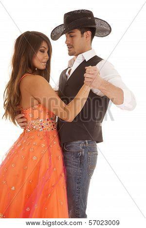 Cowboy Woman Orange Dress Dance Close