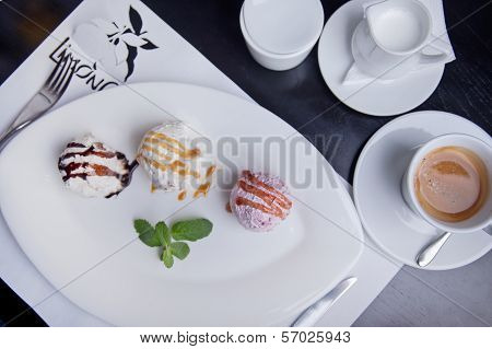 Three Balls Of Ice Cream On A Plate