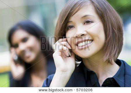 Beautiful Chinese Woman On Her Cell Phone