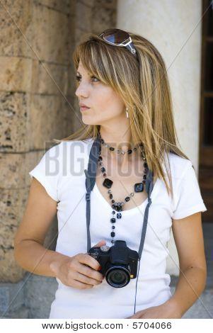 Beautiful Young Woman taking photos