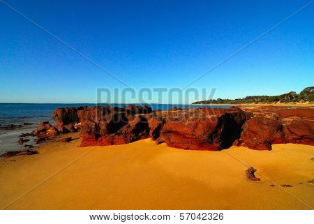 Large red rocks on beach