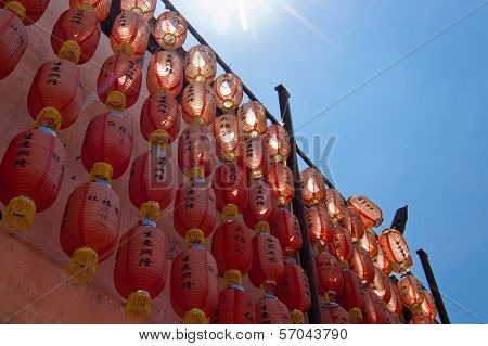 Red Chinese lanterns against blue sky