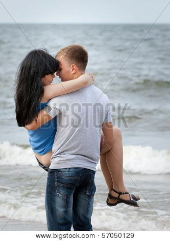 Loving Young Couple At Sea